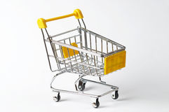 Shopping trolley. Metallic shopping trolley over white background Stock Photography