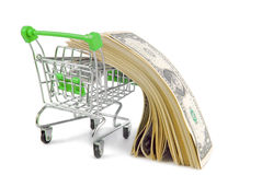 Shopping trolley with money Royalty Free Stock Photography