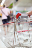 Shopping trolley in motion Stock Images