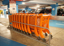 Shopping trolley. Orange, in the underground car park of a shopping center Italian Stock Photography