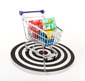 Shopping cart over target Royalty Free Stock Images