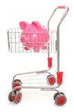 Shopping trolley with piggy bank. Cutout Stock Photo