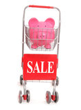 Shopping trolley with piggy bank and sale sign Royalty Free Stock Images