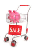Shopping trolley with piggy sale bank. Shopping trolley with piggy bank sale cutout Stock Images