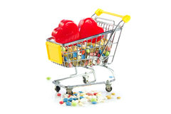 Shopping trolley with pills,heart  isolated on white background Stock Photo