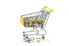 Shopping trolley with pills isolated on white background Stock Photos