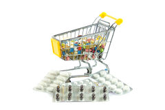 Shopping trolley with pills isolated on white background Royalty Free Stock Photography