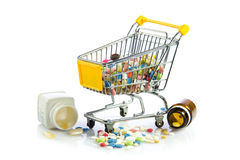 Shopping trolley with pills isolated on white background Stock Photo