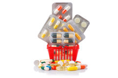 Shopping trolley with pills and medicine isolated on white Royalty Free Stock Photos