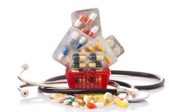 Shopping trolley with pills and medicine isolated on white Royalty Free Stock Images