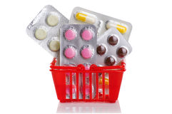 Shopping trolley with pills and medicine  on white Royalty Free Stock Images