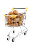 Shopping trolley and potatoes Royalty Free Stock Photography