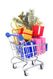 Shopping trolley with presents gifts. Isoalted on white Stock Image