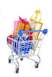 Shopping trolley with presents gifts. Isolated on white Royalty Free Stock Images