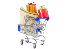 Shopping trolley with presents gifts and money Royalty Free Stock Photo