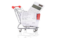 Shopping Trolley With Receipts And Calculator Royalty Free Stock Photos
