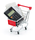 Shopping Trolley With Receipts And Calculator. Over White Background Royalty Free Stock Image