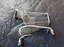Shopping trolley on river bottom in the mud Stock Image