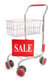 Shopping trolley with sale sign Royalty Free Stock Photos