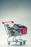 Shopping trolley. Shopping cart. Shopping trolley full of euro money - coins - currency. Symbolic example of spending money. Royalty Free Stock Photography