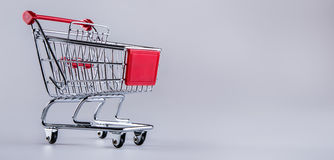 Shopping trolley. Shopping cart. Shopping trolley on muti collored background. Royalty Free Stock Image
