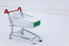 Shopping trolley in the snow Royalty Free Stock Image