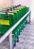 Shopping Trolley standing in a row outside. Shopping Trolley standing in a row outdoors royalty free stock photos