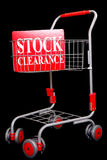 Shopping trolley with stock clearance sign. On black background Royalty Free Stock Image