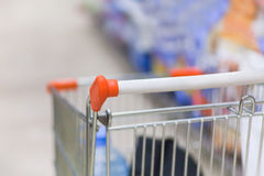 Shopping trolley in supermarket. The beginning of shopping in supermarket Stock Image