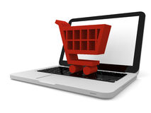 Shopping trolley symbol on laptop Royalty Free Stock Photography