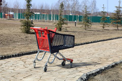 Shopping trolley on the track. Shopping trolley standing on a stone path Royalty Free Stock Photo