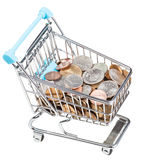 Shopping trolley with US coins isolated. On white background Stock Image