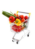 Shopping trolley and vegetables. Shopping trolley full of vegetables on white background Stock Photo