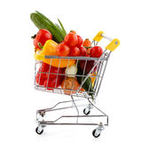 Shopping trolley and vegetables. Shopping trolley full of vegetables on white background Stock Image