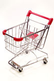 Shopping trolley on white background 8. Red and silver shopping trolley on white background Royalty Free Stock Images