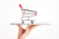 Shopping trolley on woman hand Royalty Free Stock Photo