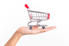 Shopping trolley on woman hand Royalty Free Stock Photos