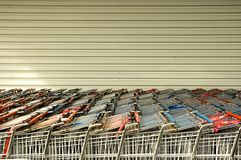 Shopping trolleys. All in a row in front of a shopping Mall Stock Image