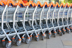 Shopping Trolleys. Row of Shopping Trolleys - Supermarket Shopping Theme Royalty Free Stock Photos