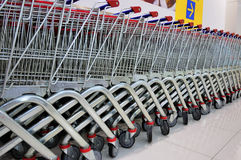 Shopping Trolleys. Row of Shopping Trolleys - Supermarket Shopping Theme Stock Images