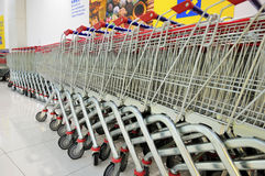 Shopping Trolleys. Row of Shopping Trolleys - Supermarket Shopping Theme Stock Image