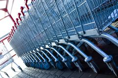 Shopping trolleys. Business - shopping with red handles trolleys outside supermarket Royalty Free Stock Photography