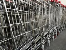 Shopping trolleys near the mall in parking.  Royalty Free Stock Image