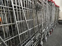 Shopping trolleys near the mall in parking.  Royalty Free Stock Photos