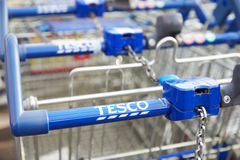 Shopping Trolleys Outside Tesco Supermarket Stock Photos