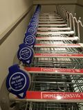 Shopping trolleys. Row of shopping trolleys Stock Images