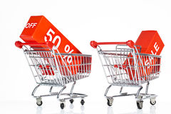Shopping trolleys with sales signs Stock Photos