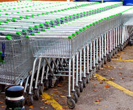 Shopping Trollies. Lines of shopping trollies waiting to be collected outside a Asda sulermarket at Sutton-in-Ashfield, Nottinghamshire, UK. in November 2011 Royalty Free Stock Images