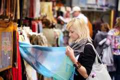 Shopping turist. Young blond girl sopping some muslim goods Stock Image