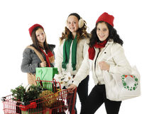 Shopping Tweens. Three tween girls Christmas shopping together.  On a white background Royalty Free Stock Photography